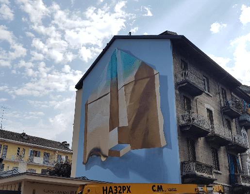 Murales Goal 12: Responsible Consumption and Production di Nevercrew a Torino per il progetto di arte urbana TOward 2030