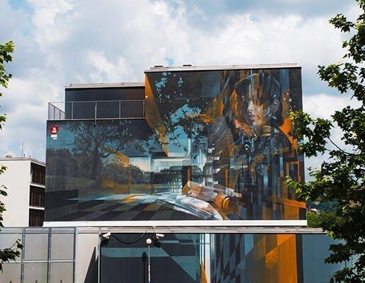 Murales Goal 4: Quality Education di Gomez a Torino per il progetto di arte urbana TOward 2030